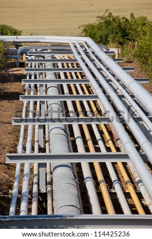 Large pipeline construction inside oil refinery - stock photo