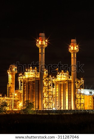 Large power plant at night - stock photo