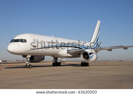 Large Private Jet Airplane A large private jet airplane with custom paint. Horizontal. - stock photo