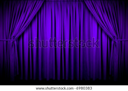 Large purple curtain with spot light and fading into dark. - stock photo