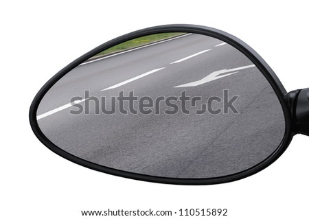 Large rear view mirror reflecting road, left side lateral, macro closeup, tarmac asphalt background reflection, white lines, arrows marking - stock photo