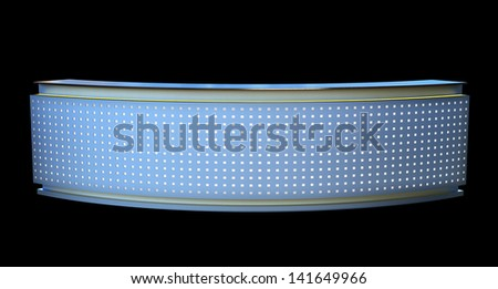 large reception counter with glowing perforated plastic panel - stock photo
