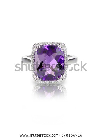 Large Rectangle purple amethyst cushion cut diamond halo fashion cocktail or engagement ring. - stock photo