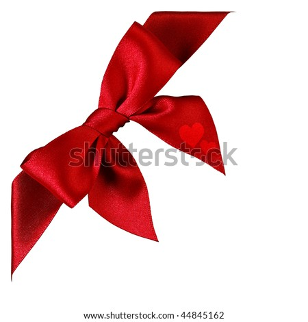 Large red bow with two printed heart shapes isolated in white - stock photo