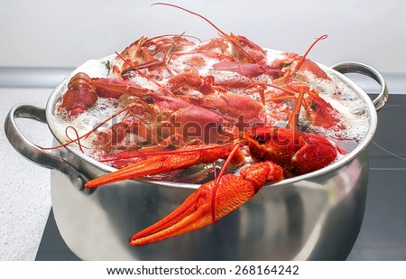 large red crabs cooked in a pot on the stove - stock photo