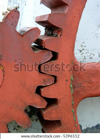 Large red gears from a rock crusher - stock photo