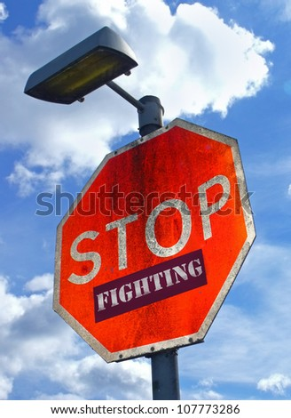 Large red road sign with the words Stop Fighting. - stock photo