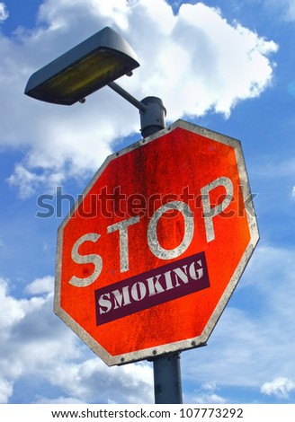 Large red road sign with the words Stop Smoking. - stock photo
