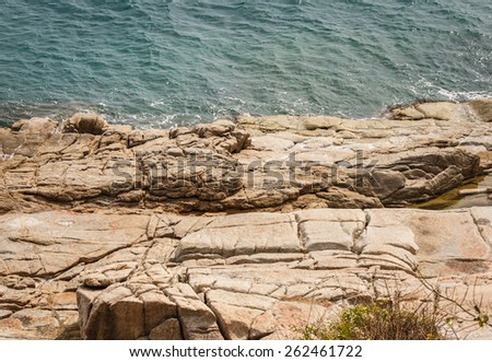 Large rock on the sea - stock photo