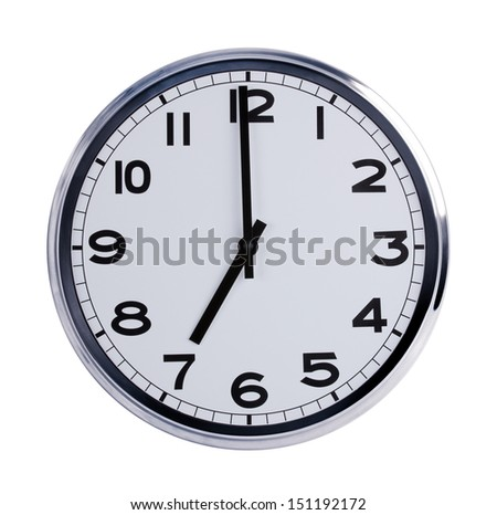 Large round office clock shows seven o'clock - stock photo