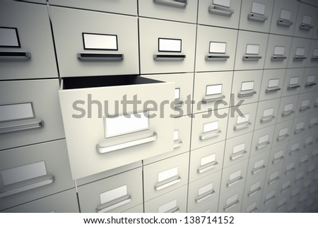 Large rows of grey file cabinets. Wall of cabinets with one drawer open.