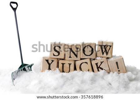 """Large, rustic alphabet blocks in snow arranged to spell out """"SNOW YUCK!""""  A green shovel is stuck in the snow nearby.  On a white background. - stock photo"""