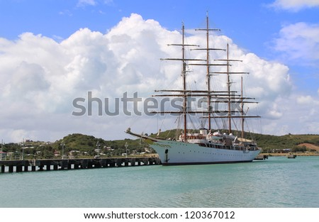 Large sailing ship docked in St. John�s Harbour in Antigua Barbuda. - stock photo