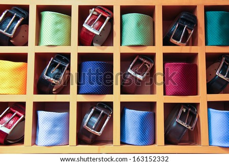 Large selection of ties and belts on sale - stock photo