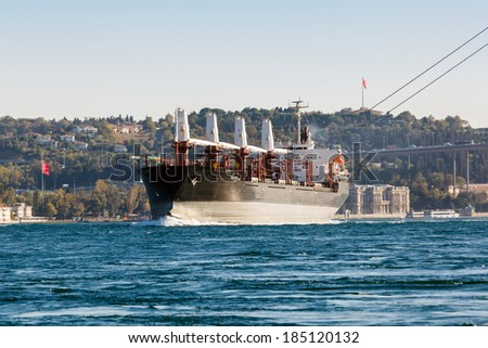 large ship tanker proceeding along the Bosphorus coast on the background - stock photo