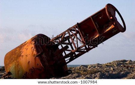 large shipping bouy on moonscape beach - stock photo