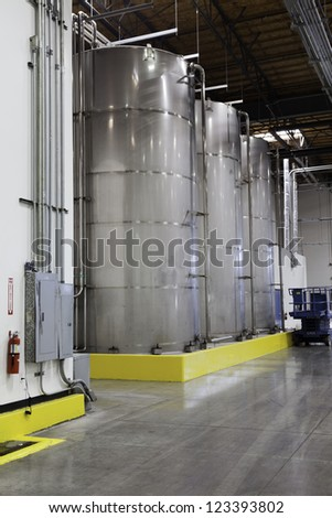 Large silos in bottling industry - stock photo