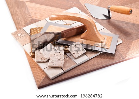 Large size ceramic tile for floor and walls, trowel, spatula on a white background - stock photo