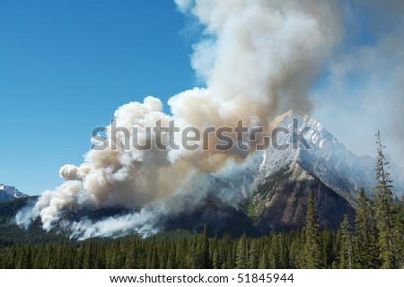 Large smoke plume from forest fire - stock photo