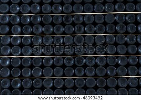 Large stack of many wine bottle bottoms - stock photo
