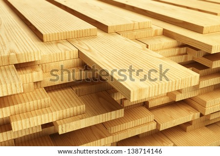 Large stack of wood planks. - stock photo