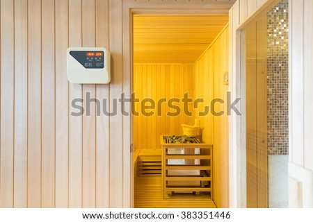 Large standard-design classic wooden sauna interior in public building - stock photo