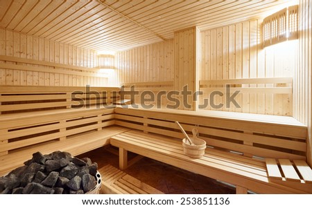 Large standard-design Finland-style classic wooden sauna interior in public building, hotel - stock photo