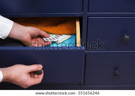 large stash of money for a rainy day, hidden at home - stock photo