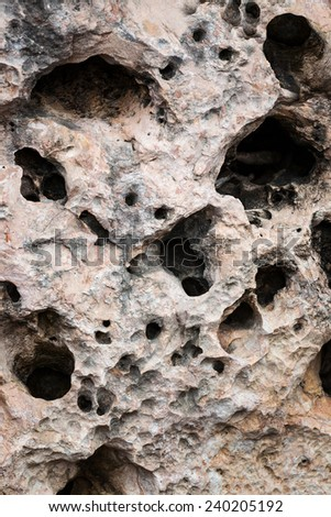 large stone with holes close up - stock photo