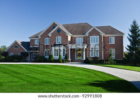 Large suburban homes in autumn - stock photo