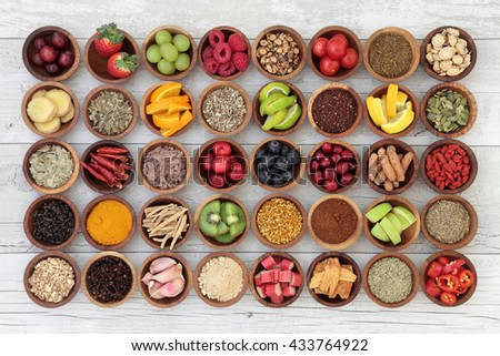 Large superfood selection for cold and flu remedy to boost immune system. High in antioxidants, anthocaynins, vitamins and minerals. - stock photo