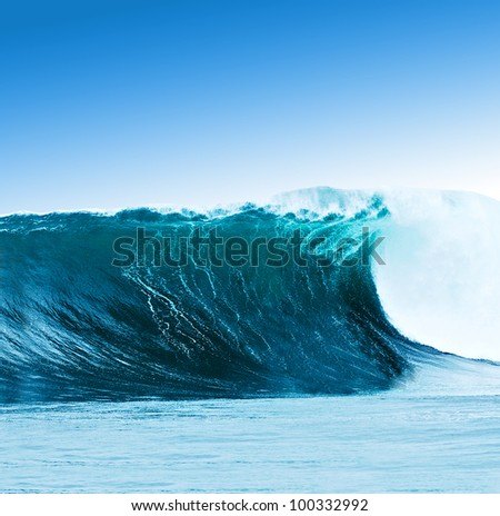 Large surfing wave breaks in the ocean