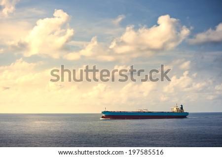 Large Tanker ship move on the sea, vintage scene - stock photo