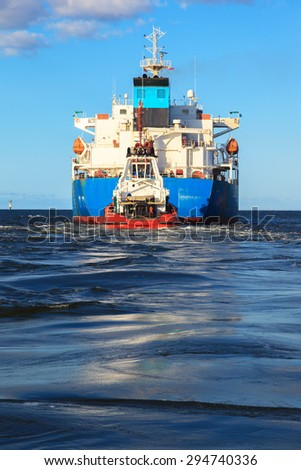 Large tanker ship on route to sea. - stock photo