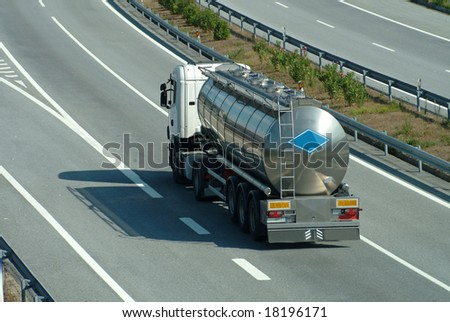 Large tanker truck rolling on highway - stock photo