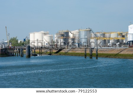 large tanks for petrol and oil in the Rotterdam harbor - stock photo