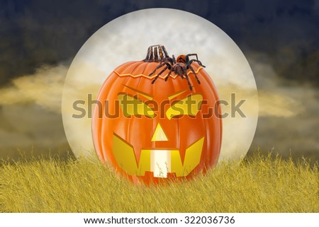 Large tarantula spider crawling over a carved jack-o-lantern pumpkin with a scary expression that is sitting in a field of wheat at night in the moonlight - stock photo