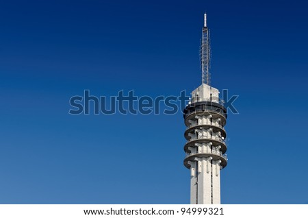 Large telecommunications tower against a clear blue sky - stock photo