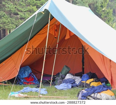 large tent of boy scout camp with backpacks and sleeping bags - stock photo