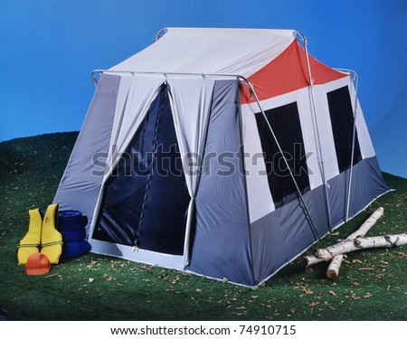 Large tent on grass and blue background camping outdoors