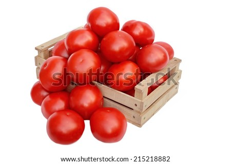 Large tomatoes in the wooden box  isolated on white background