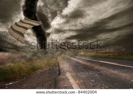 Large tornado over a road - stock photo