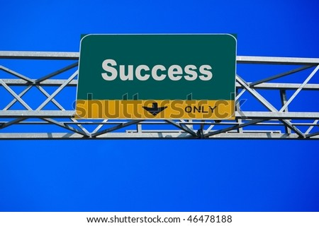 Large traffic billboard the word success on it