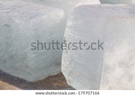 large translucent cubical block of ice cold  - stock photo
