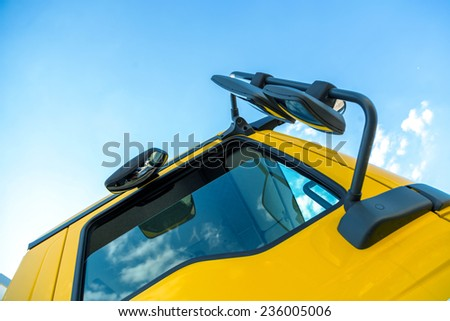 Large truck details against blue sky - stock photo