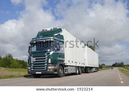 large truck, lorry driving in countryside - stock photo