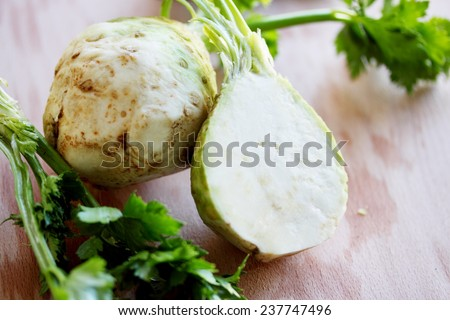Large tubers fresh celery on a wooden board - stock photo