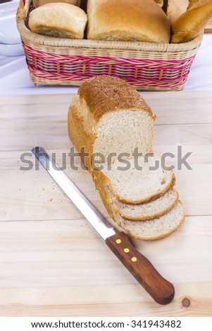 large variety of bread in basket and slice - stock photo