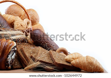 large variety of bread, still life isolate on a wooden table over white.
