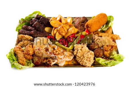 Large variety plate with meat and pickles - stock photo